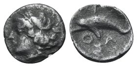 ISLANDS OFF THRACE, Thasos. Circa 412-404 BC. Hemiobol (Silver, 7 mm, 0.24 g, 8 h). Head of nymph to left. Rev. ΘΑΣ Dolphin swimming to left. HGC 6, 3...