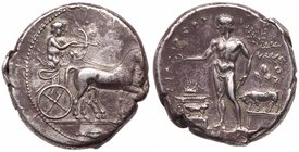 Sicily, Selinos. Silver Tetradrachm (17.34 g), ca. 455-409 BC. ΣEΛ-IN-[ONTION], Artemis, holding reins, driving quadriga right; beside he...