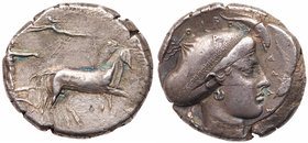 Sicily, Syracuse. Second Democracy. Silver Tetradrachm (17.26 g), 466-405 BC. Reverse die signed by A… Ca. 425-420 BC. Charioteer, holding rein...