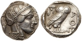 Attica, Athens. Silver Tetradrachm (17.16 g), ca. 440-404 BC. Helmeted head of Athena right, frontal eye. Reverse: AΘE, owl standing right, head...