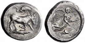 Greek Coins   Catana  Tetradrachm shorly after 466, AR 17.22 g. Man-headed bull (the river-god Amenanos) swimming r.; above, stork l. In exergue, fish...
