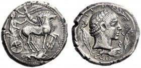 Greek Coins   Leontini  Tetradrachm of the Demareteion type circa 470, AR 17.14 g. Slow quadriga driven r. by charioteer holding kentron and reins; ab...
