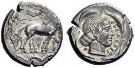 Greek Coins   Syracuse  Tetradrachm circa 460-440, AR 17.11 g. Slow quadriga driven r. by charioteer, holding reins and kentron ; above, Nike flying r...