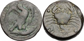 Sicily. Akragas. AE Hemilitron, c. 425-410 BC. D/ Eagle standing right, head raised, clutching fish in talons. R/ Crab clutching eel in claw; conch sh...