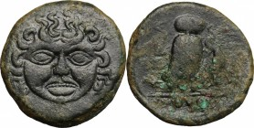 Sicily. Kamarina. AE Tetras, 425-405 BC. D/ Gorgoneion. R/ Owl standing right, head facing, holding lizard; in exergue, three pellets. CNS III, 8. AE....