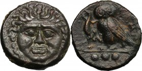 Sicily. Kamarina. AE Tetras, 425-405 BC. D/ Gorgoneion. R/ Owl standing left, head facing, holding lizard; in exergue, three pellets. CNS III, 20. AE....