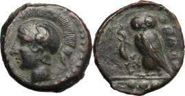 Sicily. Kamarina. AE Tetras, 425-405 BC. D/ Head of Athena left, helmeted. R/ Owl standing left, head facing, holding lizard; in exergue, three pellet...
