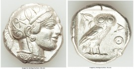 ATTICA. Athens. Ca. 440-404 BC. AR tetradrachm (24mm, 17.22 gm, 1h). AU. Mid-mass coinage issue. Head of Athena right, wearing crested Attic helmet or...