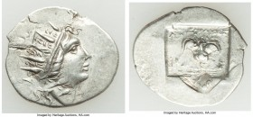 CARIAN ISLANDS. Rhodes. Ca. 88-84 BC. AR drachm (19mm, 2.17 gm, 11h). XF, die rotation. Plinthophoric standard, Lysimachus, magistrate. Radiate head o...