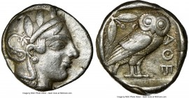 ATTICA. Athens. Ca. 455-440 BC. AR tetradrachm (24mm, 17.15 gm, 4h). NGC VF 5/5 - 4/5. Early transitional issue. Head of Athena right, wearing crested...