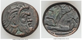 CIMMERIAN BOSPORUS. Panticapaeum. 4th century BC. AE (21mm, 8.14 gm, 11h). Choice VF. Bearded head of Pan right / Π-Α-Ν, forepart of griffin left, stu...