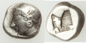 IONIA. Phocaea. Ca. late 6th century BC. AR hemihecte (9mm, 1.35 gm). About VF. Phocaic standard. Archaic female head left, wearing saccos with feathe...