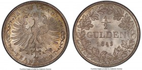 Frankfurt. Free City 1/2 Gulden 1849 MS67 PCGS, KM330. Highly attractive with strong central detail and a mottling of champagne color throughout the r...