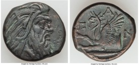 CIMMERIAN BOSPORUS. Panticapaeum. Ca. 4th century BC. AE (21mm, 6.69gm, 6h). XF. Head of bearded Pan right / Π-A-N, forepart of griffin left, sturgeon...