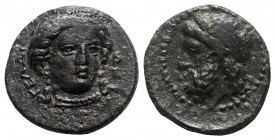 Sicily, Gela, c. 315-310 BC. Æ (13.5mm, 2.76g, 11h). Head of Demeter facing slightly r., wearing wreath of grain ears. R/ Horned and bearded head of G...