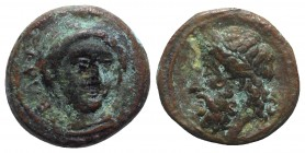 Sicily, Gela, c. 315-310 BC. Æ (13mm, 2.70g, 12h). Head of Demeter facing slightly r., wearing wreath of grain ears. R/ Horned and bearded head of Gel...