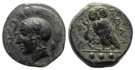 Sicily, Kamarina, c. 410-405 BC. Æ Tetras (14.5mm, 3.42g, 1h). Head of Athena l., wearing crested Corinthian helmet; olive-spray before. R/ Owl standi...