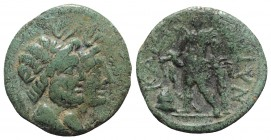 Sicily, Katane, late 3rd century BC. Æ (17mm, 4.63g, 9h). Jugate busts of Serapis and Isis; grain-ear behind. R/ Apollo standing slightly l., leaning ...