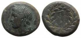 Sicily, Syracuse. Pyrrhos (278-276 BC). Æ Litra (24mm, 13.37g, 11h). Wreathed head of Persephone l.; grain ear behind. R/ Torch within wreath. CNS II,...