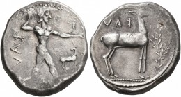 BRUTTIUM. Kaulonia. Circa 475-425 BC. Didrachm or Nomos (Silver, 22 mm, 7.95 g, 5 h). KAV[Λ] Apollo, nude, advancing to right, with a laurel branch in...