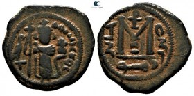 Time of Mu'awiya I ibn Abi Sufyan AD 661-680. (AH 41-60). Imperial standing figure type (Type VI). Struck circa AD 660s-680. Dimashq (Damascus) mint. ...